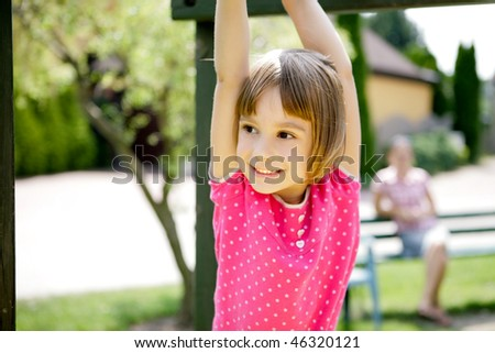 Mother and daughter having fun on playground