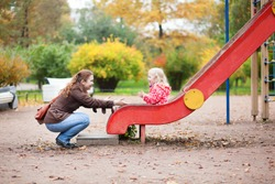 Mother and daughter having fun together on playground