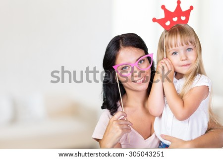 Mother and daughter having fun with photo props #305043251