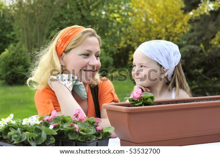 Mother and daughter having gardening time