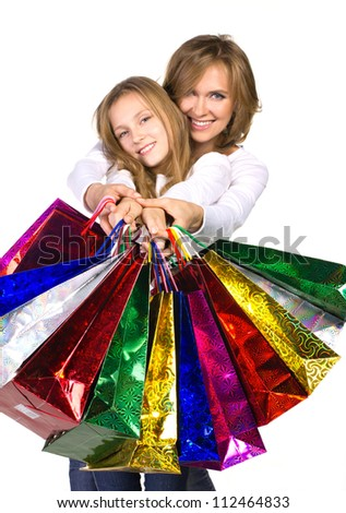 mother and daughter holding out many shopping bags isolated on white