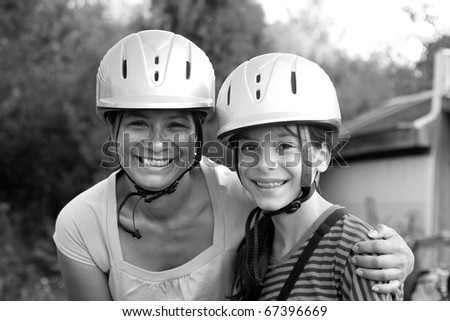 mother and daughter horseback riding