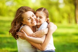 mother and daughter hugging in love playing in the park