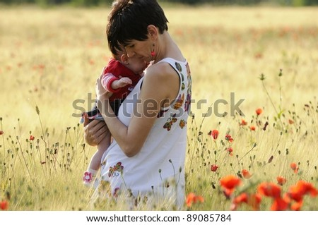 Mother and daughter in a poppy field