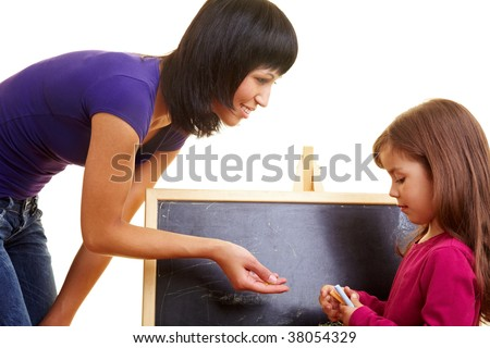 Mother and daughter in front of a chalkboard