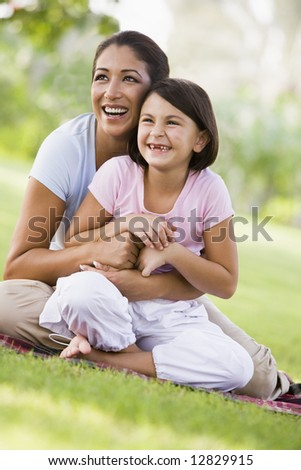 Mother and daughter in park together