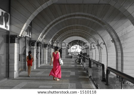 mother and daughter in red in a modern arches architecture alley