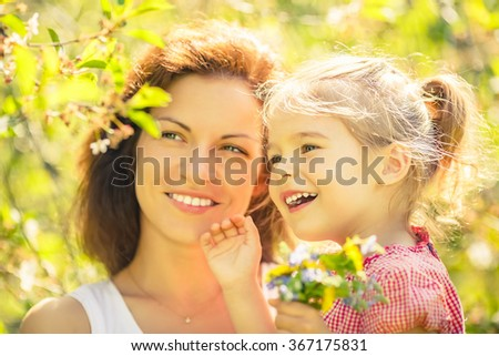 Mother and daughter in spring sunny park #367175831