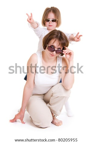 Mother and daughter in sunglasses on white background.