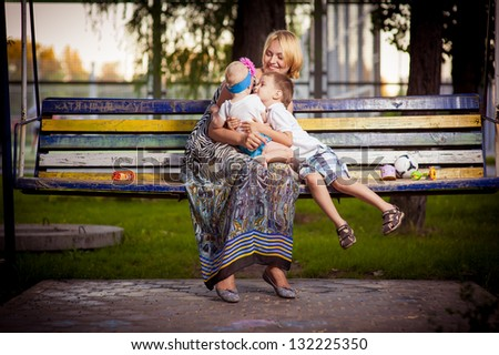 Mother and daughter in the park. Mother and her child enjoy the early spring. Happiness - mother with her child.Young mother with child outside on a summer day. mother playing with her son in the park