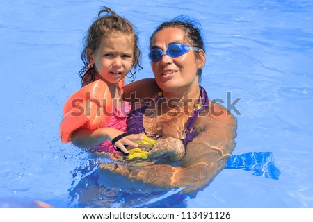Mother and daughter in the swimming pool