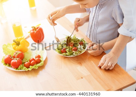 Mother and daughter making salad #440131960