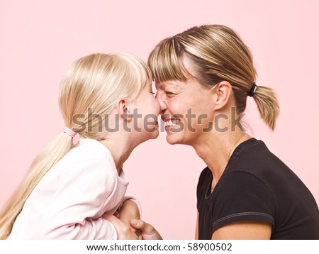 Mother and daughter on pink background
