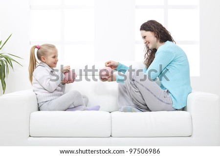 Mother and Daughter on sofa learn about savings