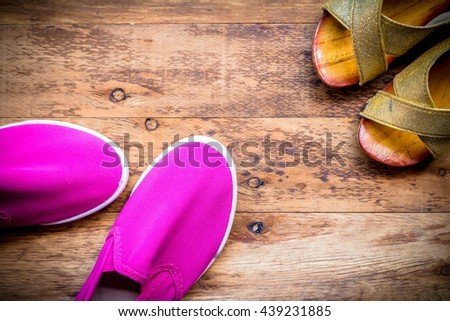 Mother and Daughter pink shoes on wooden background, Mothers Day. #439231885