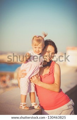 Mother and daughter playing outdoors in summer