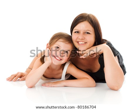 Mother and daughter posing together isolated on white