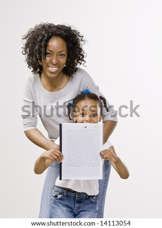 Mother and daughter posing with school report