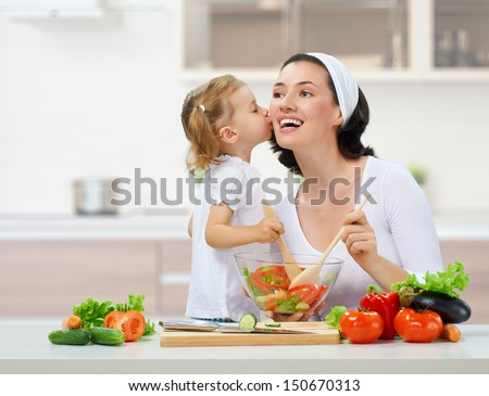 mother and daughter prepare salads