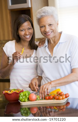 Mother And Daughter Preparing A meal,mealtime Together