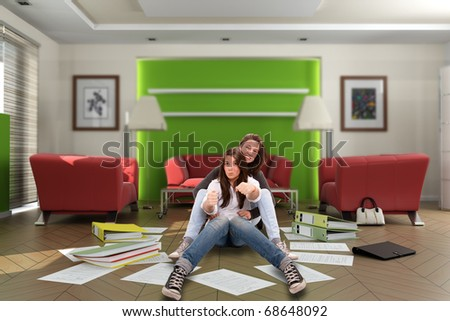 Mother and daughter pretending to drive in their living room