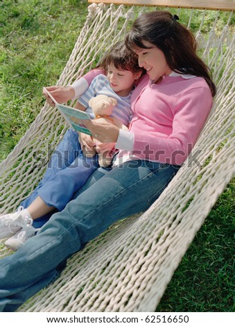 Mother and daughter reading in a hammock
