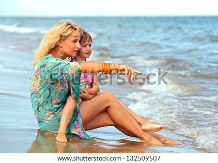Mother and daughter resting on the coast of the Black Sea