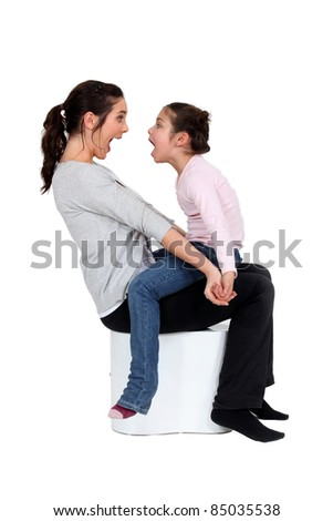 Mother and daughter shouting at each other
