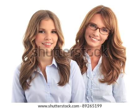 Mother and daughter smiling against white background