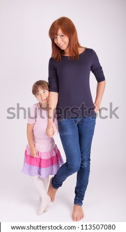 Mother and daughter together in front of a camera