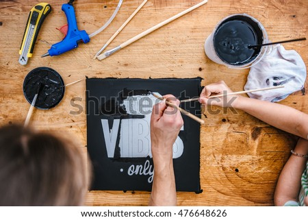 Mother and daughter together painting canvas at home - Shutterstock ID 476648626