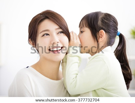 mother and daughter whispering gossip