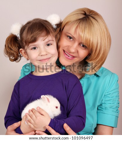 mother and daughter with dwarf white bunny