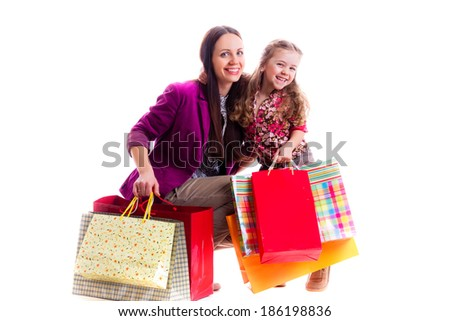 mother and daughter with shopping bags, isolated on white background