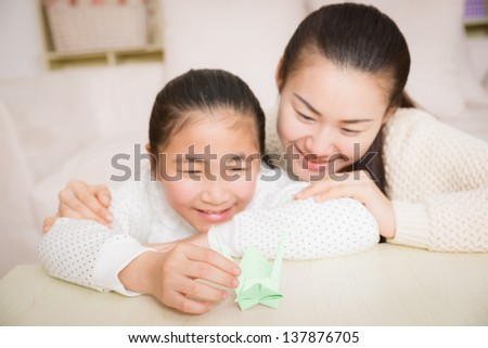 mother and daughter with the paper crane