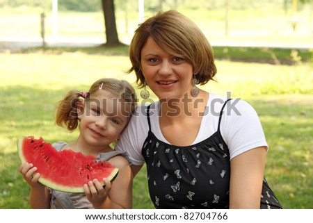 mother and daughter with watermelon