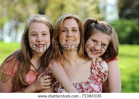 Mother and Daughters portrait outdoors on a sunny day