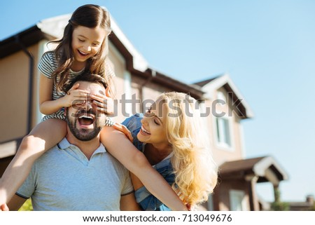 Mother and father having fun with their daughter outside #713049676
