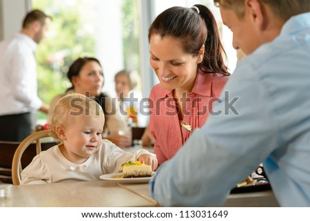 Mother and father with child eating cake woman man cafe