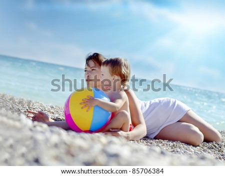 mother and girl in the beach