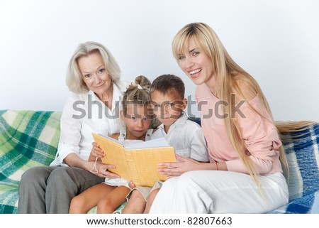 Mother and grand mother read book with children