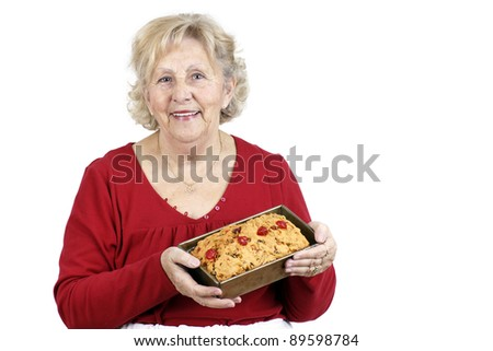 Mother and grand-mother welcoming her family with a smile and a freshly baked home made fruit cake.