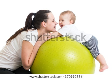 mother and her baby having fun with gymnastic ball