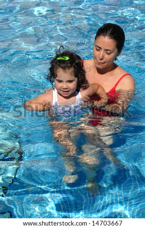mother and her baby in the swimming pool