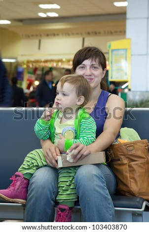 Mother and her child at airport