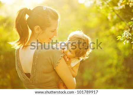 Mother and her child enjoy the early spring