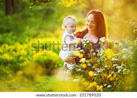 Mother and her child in spring park