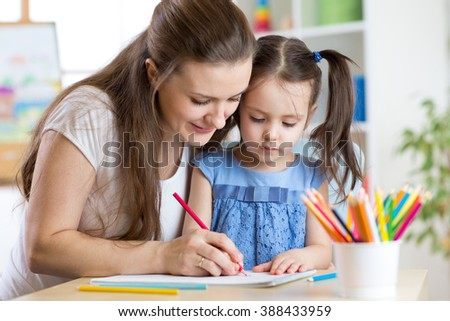 mother and her child pencil together #388433959