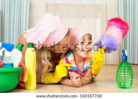 mother and her child ready to room cleaning - stock photo