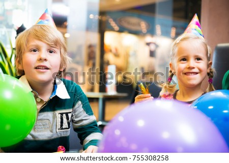 mother and her children having a birthday party at a cafe